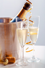 Pair glass of champagne with bottle in metal container. New Year celebration © fotofabrika