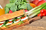 Bread sandwich with egg, arugula salad, tomatoes and radish