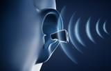 Hörgerät am Ohr mit Schall - Symboldarstellung - 237375580