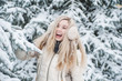 Quadro Beautiful smiling woman has a fun with snow outdoor. Lifestyle. Winter holidays.