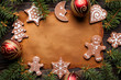 Blank paper sheet, gingerbread Christmas cookies, spruce tree and baubles