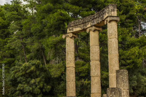 pillars colonnade antique ruins temple of ancient Greece in park garden outdoor environment, tourist tour concept