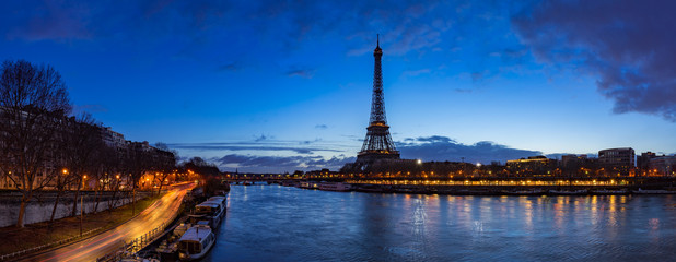 Eiffel Tower and Seine River banks in early morning light. Panoramic view in Paris, France
