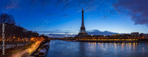 Eiffel Tower and  Seine River banks in early morning light. Panoramic view in Paris, France - 237408564