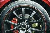Completed in a high quality gloss. Black rim of luxury car wheel. Car wheel detail. Alloy wheel. Wheel and rim. Front or rear. Contemporary multi spoke design. Great modern styling
