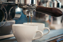 """Постер, картина, фотообои """"Enjoy barista style coffee. Coffee being brewed in coffeehouse or cafe. Espresso making with portafilter. Coffee cups. Small cups to serve hot drinks. Brewing coffee with espresso machine"""""""