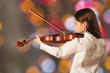 Young happy cheerful girl with violin