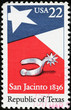 Flag of Texas and spur on american stamp