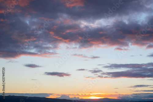 sunset over the landscape and trees