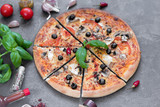 Pizza, food, vegetable, mushrooms.  Vegetables, mushrooms and tomatoes pizza on a black wooden background. It can be used as a background
