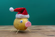 pig in christmas hat made of potato. symbol of 2019
