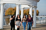 Group of four happy and pretty latino girls from Ecuador posed at street. - 237472938