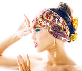 young pretty modern girl with bright shawl on head emotional pos - 237473151