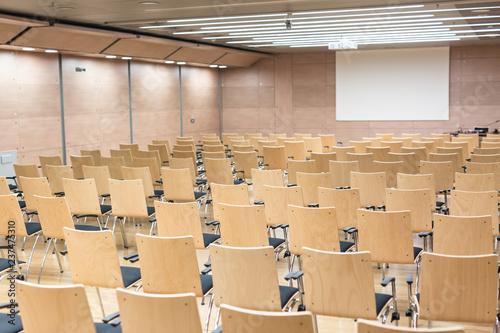 Leinwandbild Motiv View of empty wooden seats in a modrn lecture hall.