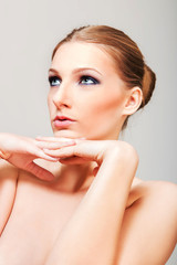 Attractive blonde topless woman with dark eye make up © Piotr Marcinski