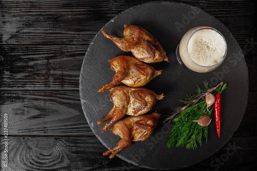 Fried quails on black table - 237481509