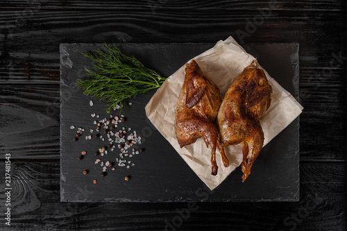 Fried quails on black table - 237481543