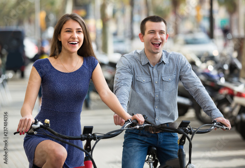 Young couple with electric bikes .