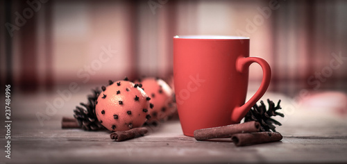 red Christmas mug ,cinnamon sticks and oranges on wooden backgr - 237484996