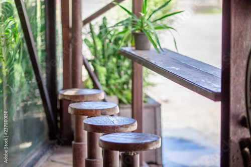 The background of modern wooden chairs, often interior (restaurants, cafes, bakeries) to attract customers to focus on the service and tell. - 237500150