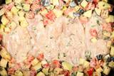 филе грудки куриной готовят с овощами на кухне  - 237509329