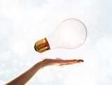 Bring your new idea presented by bulb in man hand - 237519704