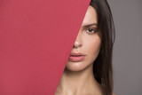 Portrait of a beautiful woman. Fashion makeup Fragment of the face. Gray background.
