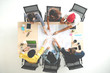 Top view of creative diverse people agree result together. Overhead view of young creative team, start up colleagues group or college student meeting and voting agree opinion by pointing hand at desk.