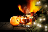 Christmas mulled on table and fireplace