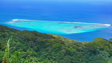 Blue tropical lagoon and green forest seen from the heights of Huahine island in French Polynesia, south Pacific ocean - 237524765