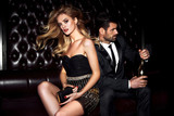 Sexy elegant couple. Beautiful woman near the man. - 237526996