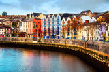 Bank of the river Lee in Cork, Ireland city center with various shops - 237535914