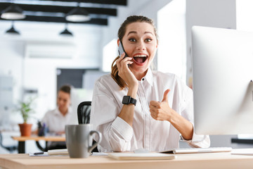 Happy young businesswoman dressed in shirt