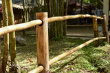 Boundary bamboo railing fence in rural area of Thailand. Bigger bamboo stalks for poles and smaller size for horizontal members. © pondpony
