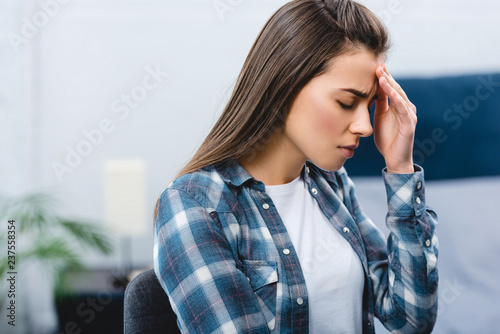 Leinwanddruck Bild sick young woman suffering from headache at home