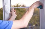 Man measuring window. Installing new window in house - 237562789