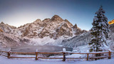 Fototapeta Landscape - Winter mountains with icy lake Sea Eye in Tatra national park. Morskie oko landscape © dzmitrock87