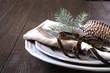 Leinwandbild Motiv Christmas table setting with silverware and dark natural evergreen decor. Close up. Holiday.