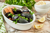 Seafood. Mussels in wine with parsley and lemon. Clams in the shells. Gourmet appetizer - 237584903