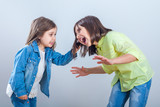 conflict between sisters, younger sister pulls the hair older sister - 237598321