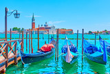 Gondolas and San Giorgio di Maggiore church in Venice
