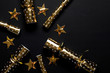 Gold festive Christmas crackers on a dark background - 237608387