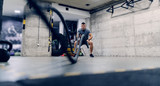 Young Caucasian man in sportswear exercising with battle ropes in a gym. - 237613530