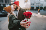 Beautiful flower with young couple on blurred background