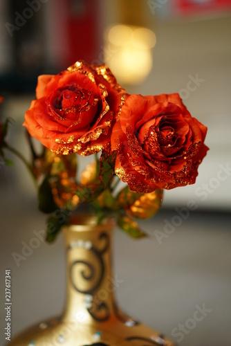 orange roses in a vase, Christmas decoration