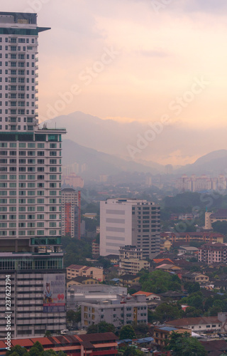 Smog and mist from recent rains create a moody atmosphere in the last light overlooking Kuala Lumpur