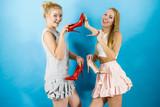 Women presenting high heels shoes - 237656589