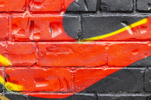 Graffiti painted on a brick wall texture. - 237682342