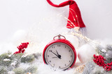 Red  alarm clock - symbol of  New Year, fir tree branches, berries,  gnome, balls  on white fur background. - 237686522