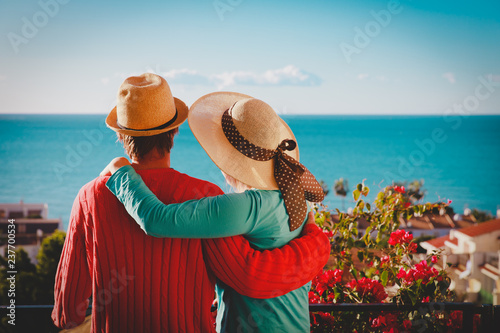 Leinwanddruck Bild happy loving couple hug on balcony terrace with sea view